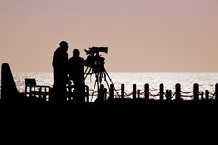 Silhouette of photographers. Photographers waiting for sea mammals on the Dorset coast, England Stock Images