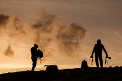 Silhouette of photographers on heal at sunset Stock Photos