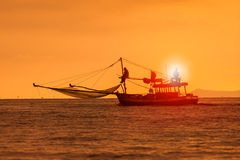 Silhouette photography of fishery boat and sunset sky over sea h. Orizontal Royalty Free Stock Images