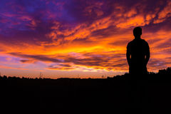 Silhouette Photography of Man Under Orange and Blue Clouds Royalty Free Stock Photography