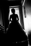 Silhouette  picture of the bride. The bride goes on a dark corridor. silhouette photo Royalty Free Stock Photos