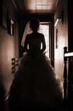 Silhouette  picture of the bride. The bride goes on a dark corridor. silhouette photo Royalty Free Stock Photo