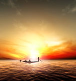 Silhouette picture fisherman nature sunset Stock Image
