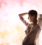 Silhouette picture of pregnant beautiful woman Stock Photo