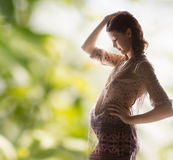 Silhouette picture of pregnant beautiful woman Stock Image