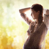 Silhouette picture of pregnant beautiful woman. Family, motherhood and pregnancy concept - silhouette backlight picture of pregnant beautiful woman stock image