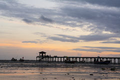 Silhouette pier at sunset. In thailand Royalty Free Stock Photo