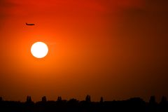 Silhouette of a plane. At sunset Royalty Free Stock Photography