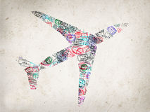 Silhouette of a plane created with passport stamps Stock Images
