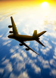 Silhouette of plane fly in the skys Royalty Free Stock Photography