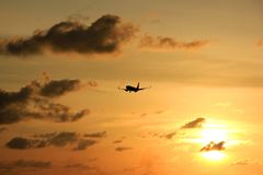 Silhouette plane at sunset Sunset in Maron Beach, Semarang, Indonesia.  Stock Photo
