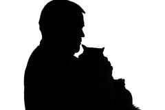 Silhouette of a plump man with a cat. Black and white silhouette of a plump man with a cat in arms Stock Image