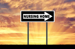 Silhouette pointer road sign nursing home Stock Image