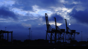 Silhouette of port cranes Royalty Free Stock Image