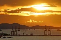 Silhouette of port warehouse and crane bridge Stock Image