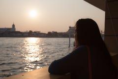 Silhouette portrait woman near river. Stock Photos
