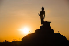 Silhouette Of The Posture Of Walking Buddhist Statue Royalty Free Stock Photos