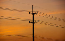 Silhouette power electric pole in evening time Royalty Free Stock Photography