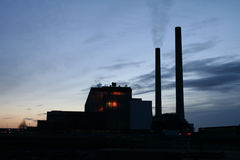 Silhouette of Power Station. Silhouette of a power station - Deep glow coming from core Royalty Free Stock Photography