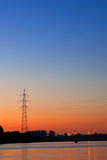 Silhouette of a power transmission line support Royalty Free Stock Photos