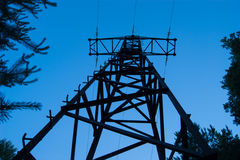 Silhouette of a power transmission line tower Stock Image