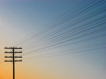 Silhouette of power-transmission pole with wires royalty free stock photos