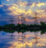 Silhouette power transmission tower during twilight time. stock photo