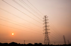 Power transmission towers with sunset Stock Photo