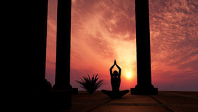 Silhouette practicing yoga. At sunset Royalty Free Stock Image