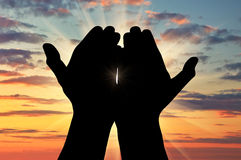 Silhouette of praying hands Stock Photos