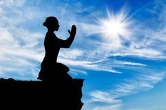 Silhouette of praying woman Royalty Free Stock Photo