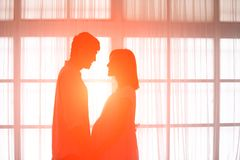 Silhouette of pregnancy couple. Silhouette of sweet pregnancy couple in front of window at home royalty free stock photo