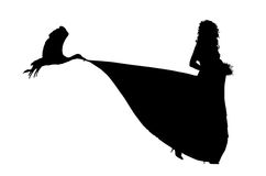 Silhouette of a pregnant bride and a storck. Carrying in its beak a train of her wedding dress Stock Photo
