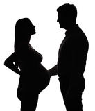 Silhouette of the pregnant couple Royalty Free Stock Photo