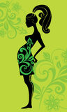 Silhouette of pregnant woman. Vector Royalty Free Stock Images