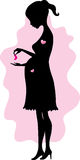 Silhouette of pregnant woman Stock Images