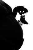 Silhouette of pregnant woman. With baby carriage on white stock photography