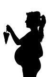 Silhouette of the pregnant woman Stock Photo