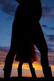 Silhouette of a pregnant woman and childs legs Royalty Free Stock Photography