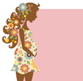 Silhouette of pregnant woman in flowers Stock Images