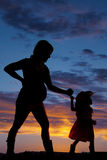 Silhouette of pregnant woman holding with a young child cowgirl Stock Image