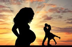 Silhouette a pregnant woman and  loving couple Stock Image