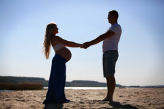 Silhouette of pregnant woman and ma Royalty Free Stock Images