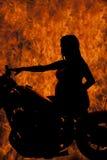 Silhouette pregnant woman sit close fire Stock Photos