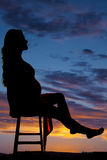 Silhouette of a pregnant woman sitting leg out Stock Photos