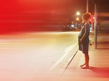 Silhouette pregnant woman standing alone on the road at night. Women, new life stock image