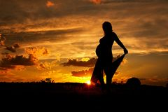 Silhouette of a pregnant woman royalty free stock photo