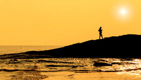 Free Silhouette Pregnant Women Standing On Rock In Sea Stock Photos - 36169773