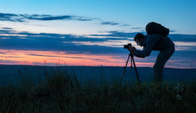 Silhouette of a professional photographer royalty free stock image