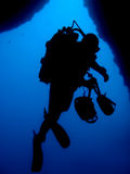 Silhouette of professional underwater photographer Stock Photo